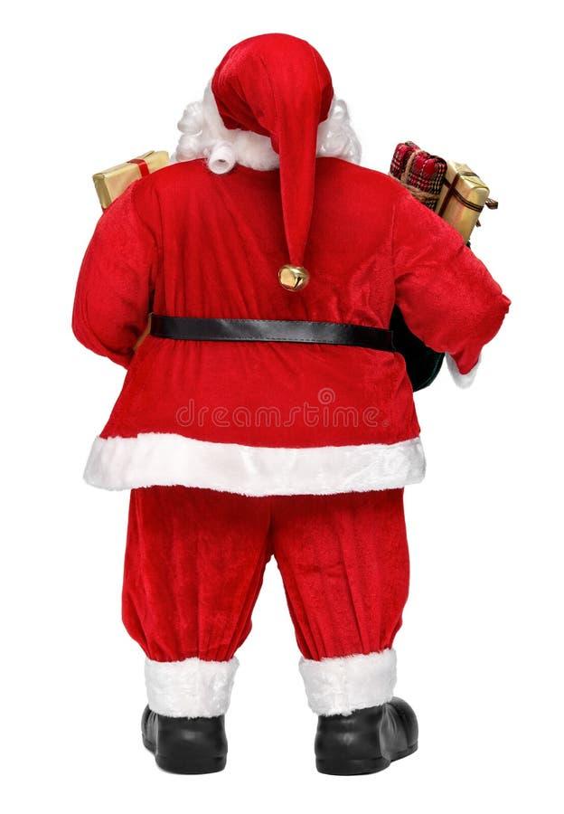 Den roliga Santa Claus dockan med gåvor tillbaka beskådar arkivfoto