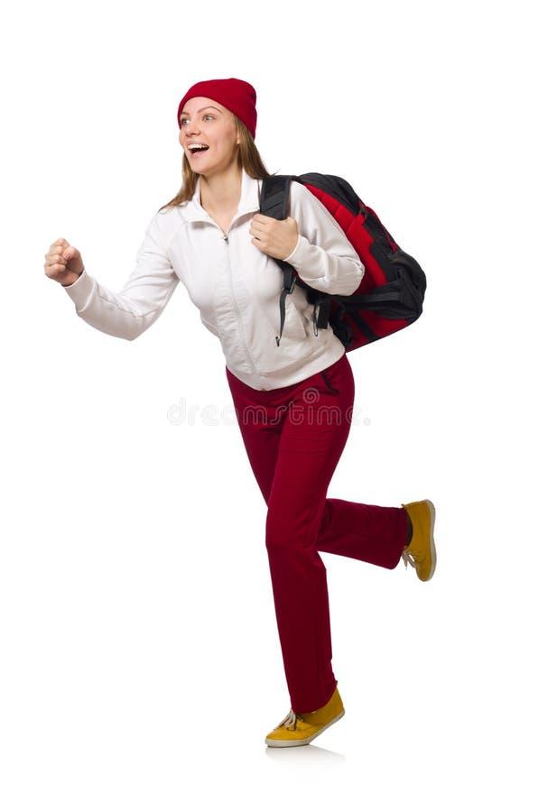 Den roliga studenten med ryggsäcken som isoleras på vit royaltyfria foton