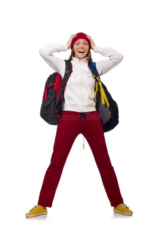 Den roliga studenten med ryggsäcken som isoleras på vit fotografering för bildbyråer