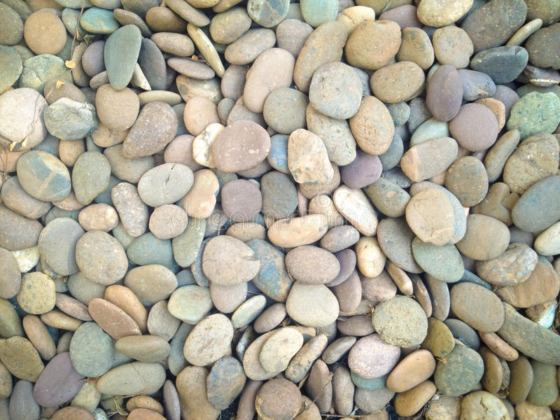 Den rundade stenen vaggar textur royaltyfria bilder