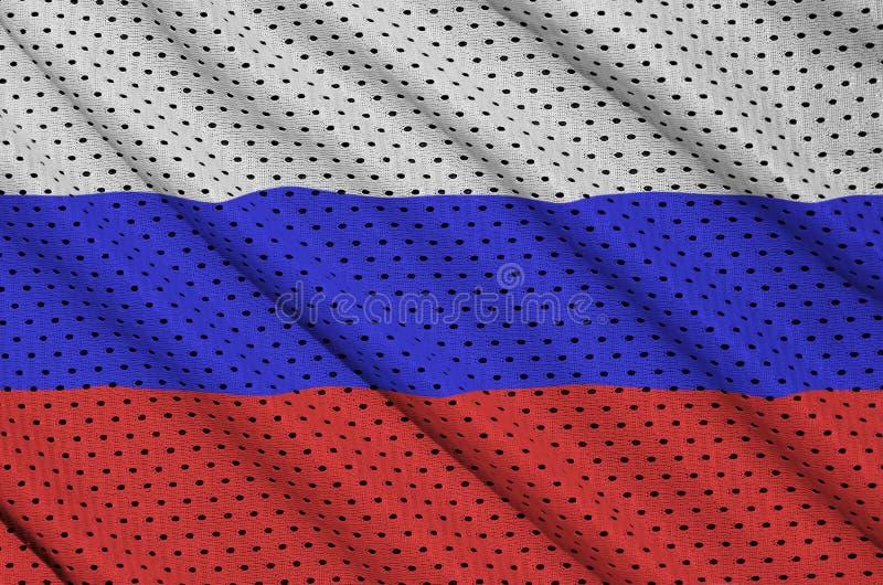 Den Ryssland flaggan skrivev ut på ett tyg för ingrepp för polyesternylonsportswear royaltyfri foto