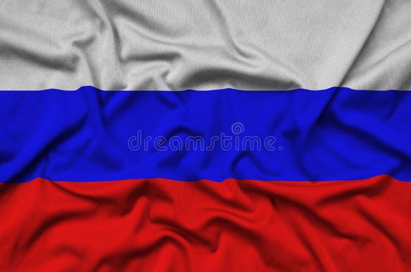 Den Ryssland flaggan visas på ett sporttorkduketyg med många veck Baner för sportlag royaltyfri fotografi