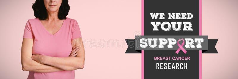 Den sammansatta bilden av kvinnor i rosa färger för bröstcancer korsar deras armar arkivbild