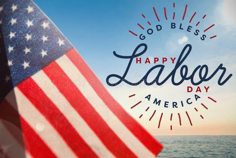 Den sammansatta bilden av den sammansatta bilden av den lyckliga arbets- dagen och guden välsignar Amerika text royaltyfri foto