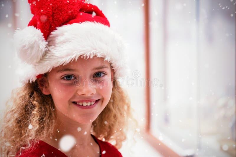 Den sammansatta bilden av ståenden av flickan i jul klär royaltyfri bild