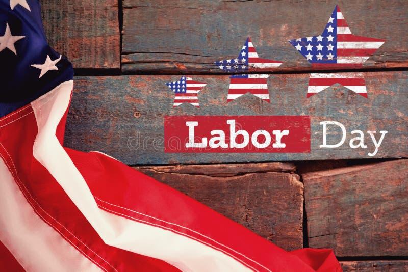 Den sammansatta bilden av den sammansatta bilden av text för den arbets- dagen med stjärnan formar amerikanska flaggan royaltyfri fotografi