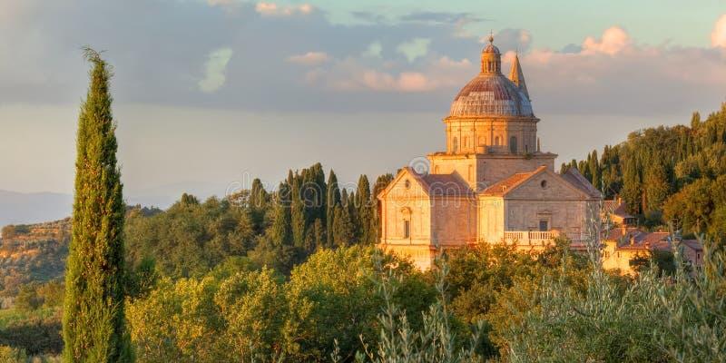 Den San Biagio kyrkan värma sig i aftonsolen arkivfoton