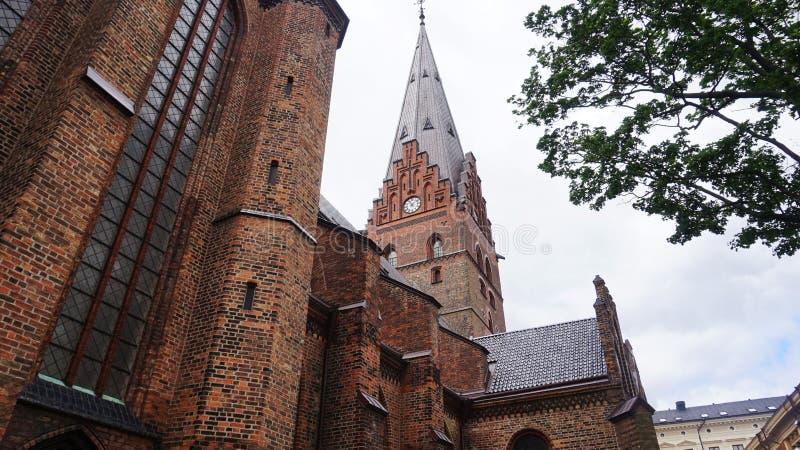 Den Sankt Petri kyrkaen är en stor kyrka i Malmö som den byggs i den gotiska stilen, och har en 105 meter det 344 ft högväxta to arkivbild