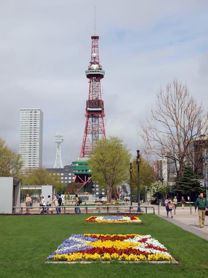Den Sapporo TV:N står hög/Odori parkerar royaltyfri bild