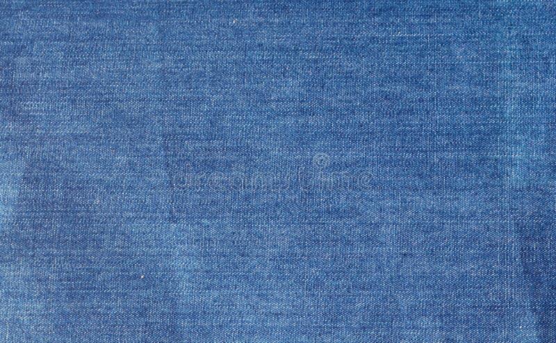 Den sjaskiga grov bomullstvilltygbakgrunden arkivfoto