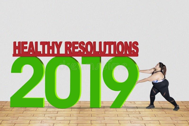 Den sjukligt feta kvinnan skjuter text av sund upplösning 2019 royaltyfria foton