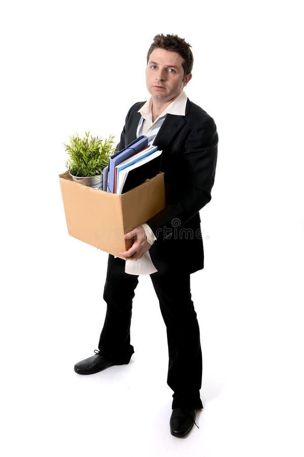 Den smutsiga affärsmannen med kartongen avfyrade från jobb arkivfoto