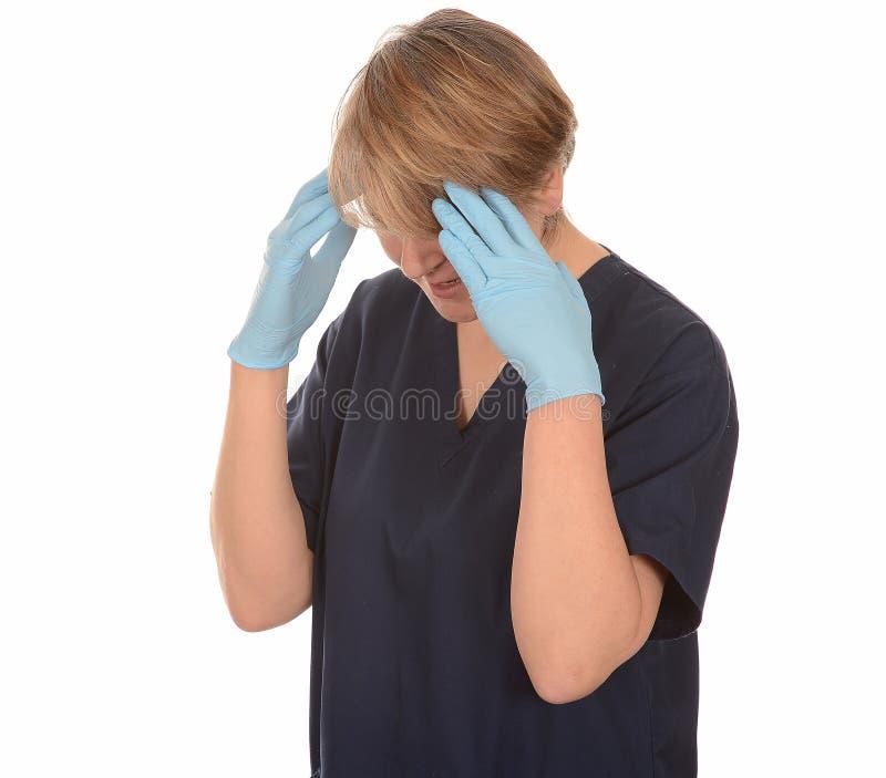 Den Stessed sjuksköterskan med huvudet räcker in royaltyfria foton