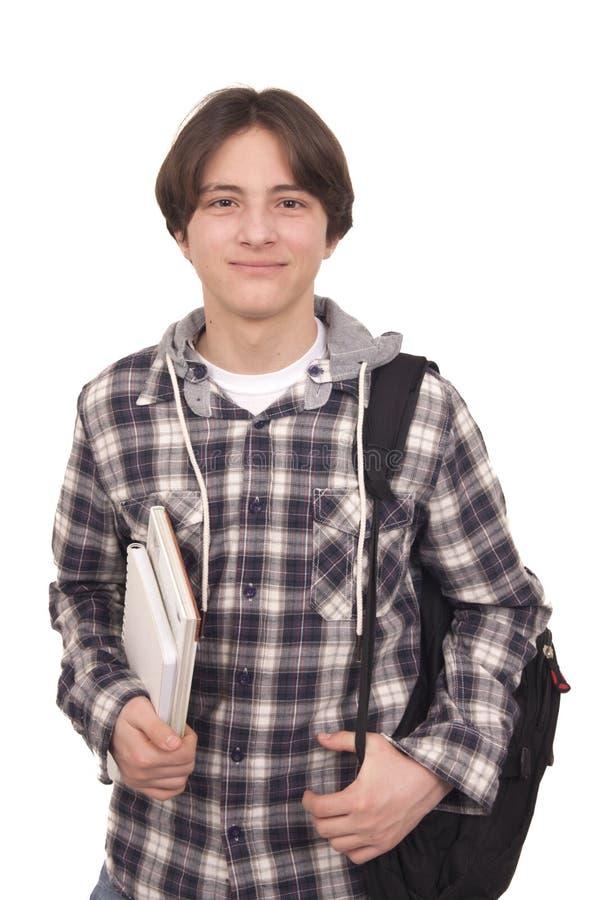 Den stiliga le tonåringen med hänger lös packen och bokar arkivfoto
