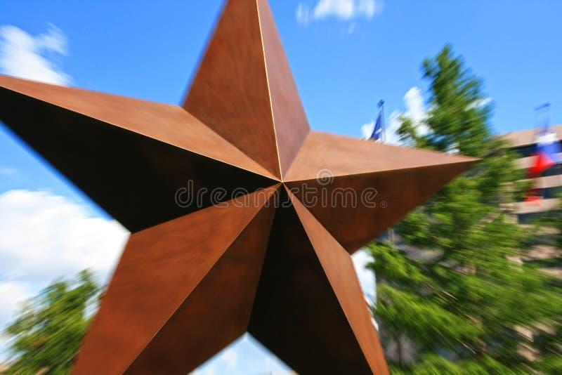 Den stora stjärnan med explosion zoomar in Austin royaltyfria bilder