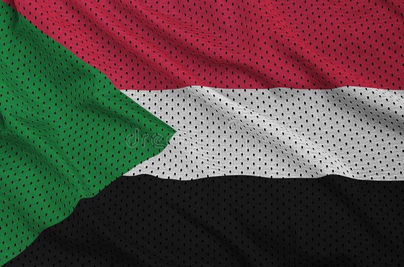 Den Sudan flaggan skrivev ut på ett tyg för ingrepp för polyesternylonsportswear w arkivbild