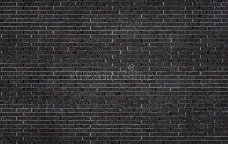 Den svart tegelstenväggen texturerar arkivfoto