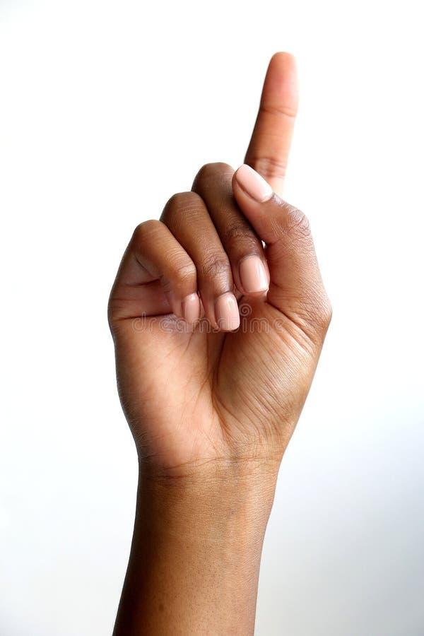 Den svarta afrikanska indiska handvisningen nummer fem, g?mma i handflatan av handen fotografering för bildbyråer