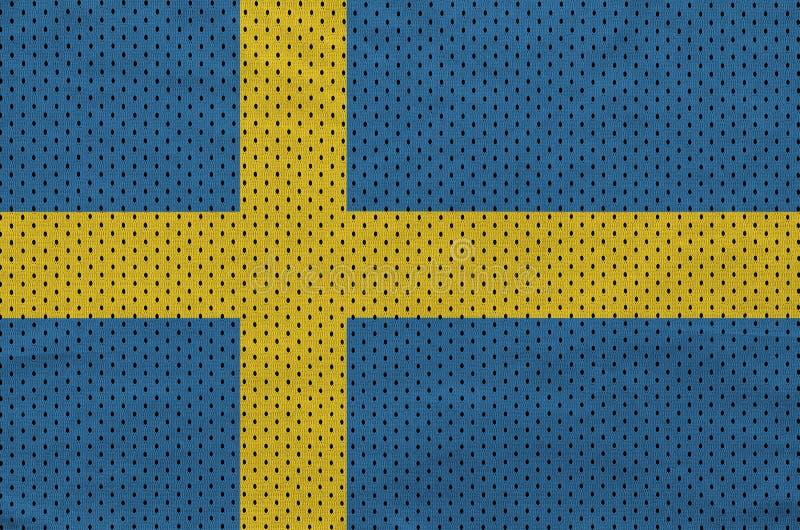 Den Sverige flaggan skrivev ut på ett tyg för ingrepp för polyesternylonsportswear arkivbild
