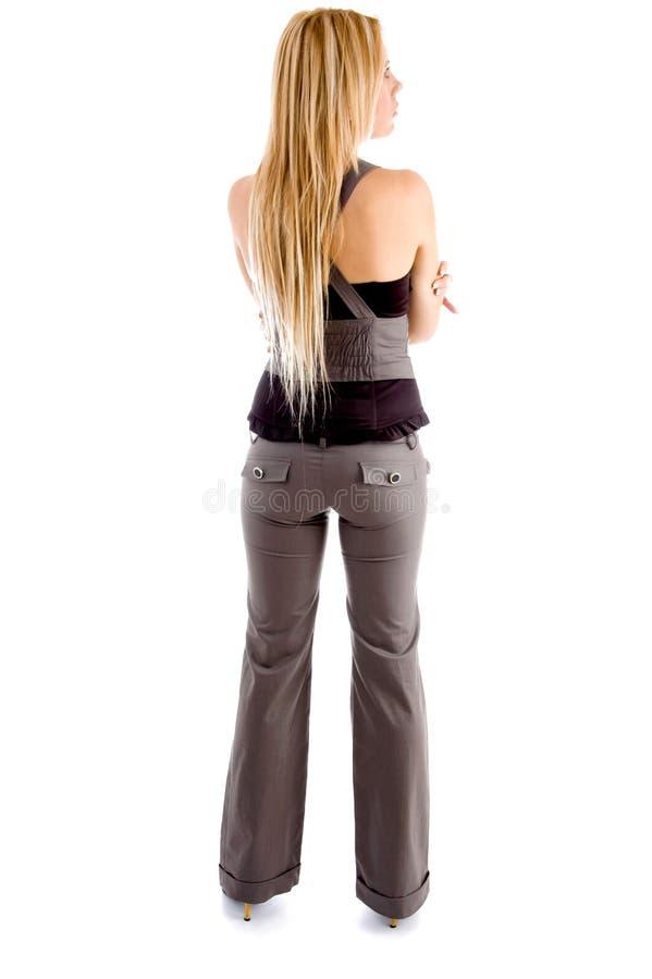 den tillbaka blonda kvinnlign poserar full arkivfoto