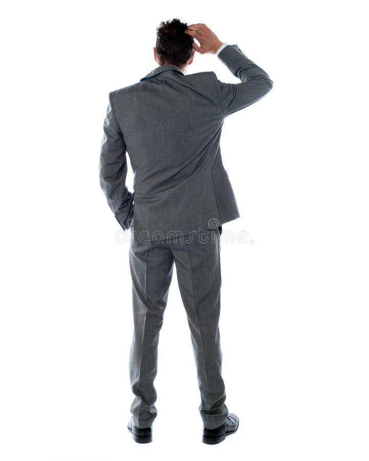 den tillbaka företags personen poserar att tänka arkivbild