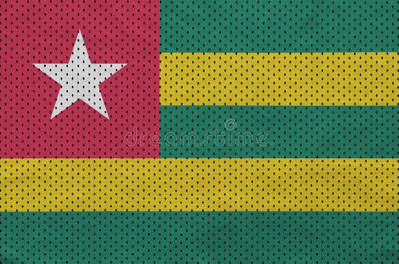 Den Togo flaggan skrivev ut på wi för ett tyg för ingrepp för polyesternylonsportswear fotografering för bildbyråer