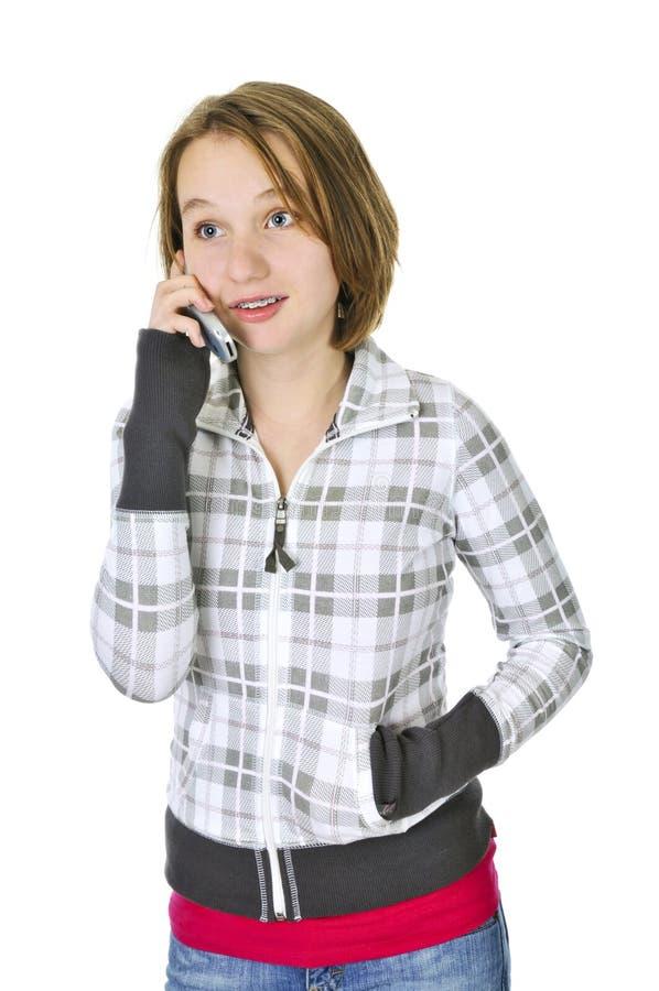 Den tonårs- flickan som talar på, ringer arkivbilder