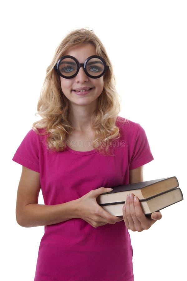 Den tonårs- kvinnliga studenten ser in camera med kuslig exponeringsglasnolla arkivbild