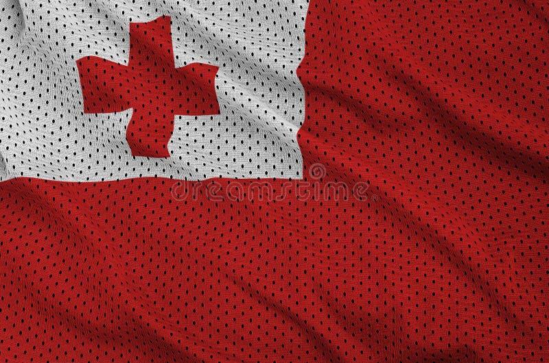Den Tonga flaggan skrivev ut på ett tyg för ingrepp för polyesternylonsportswear w royaltyfria foton
