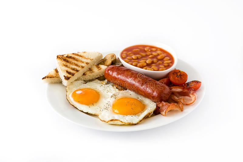 Den traditionella fulla engelska frukosten med stekte ägg, korvar, bönor, champinjoner, grillade tomater och bacon royaltyfri bild