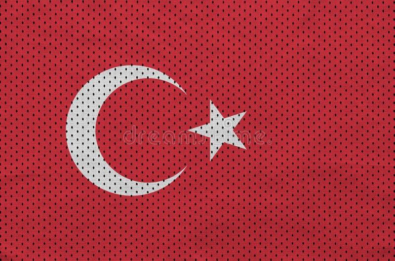 Den Turkiet flaggan skrivev ut på ett tyg för ingrepp för polyesternylonsportswear arkivbilder