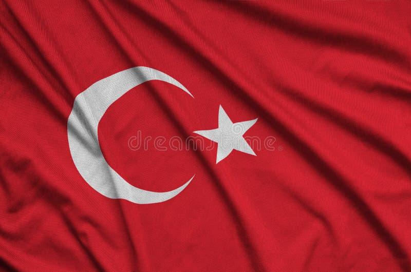 Den Turkiet flaggan visas på ett sporttorkduketyg med många veck Baner för sportlag royaltyfria foton