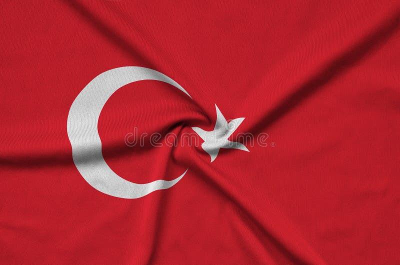 Den Turkiet flaggan visas på ett sporttorkduketyg med många veck Baner för sportlag fotografering för bildbyråer