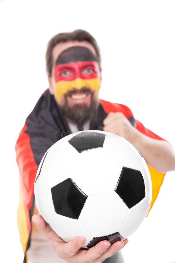 Den tyska fotbollfanen hurrar, fotboll framtill royaltyfri foto