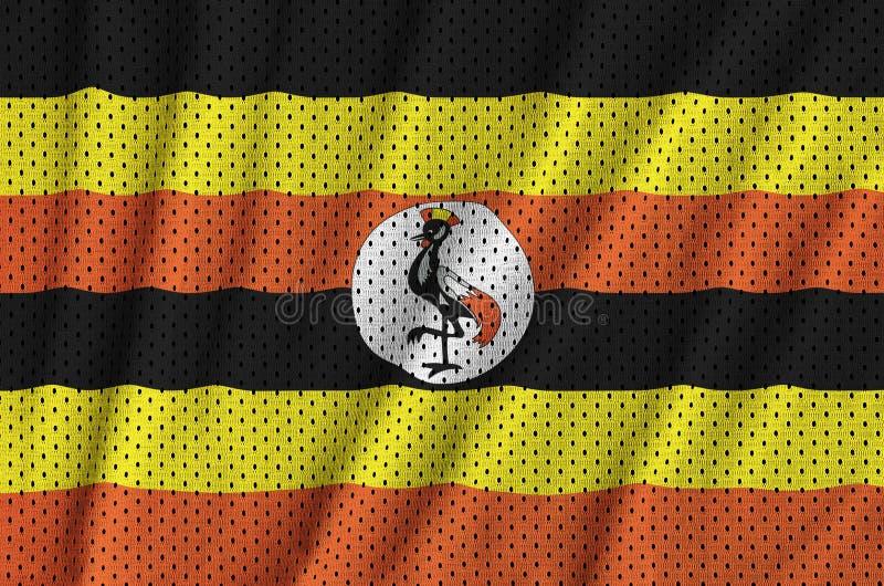 Den Uganda flaggan skrivev ut på ett tyg för ingrepp för polyesternylonsportswear royaltyfria foton