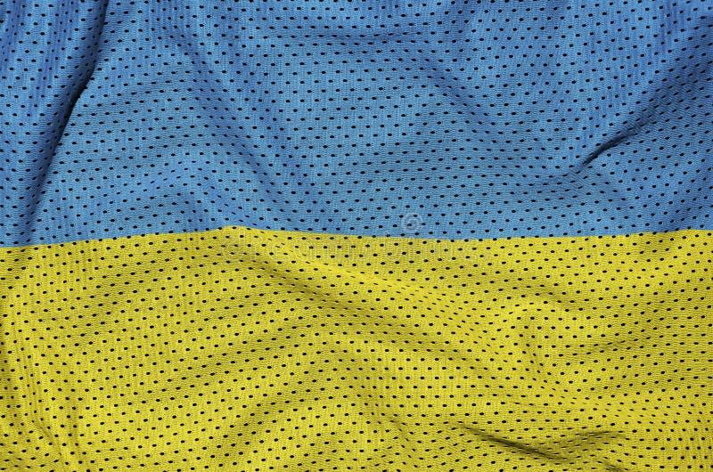 Den Ukraina flaggan skrivev ut på ett tyg för ingrepp för polyesternylonsportswear royaltyfria foton