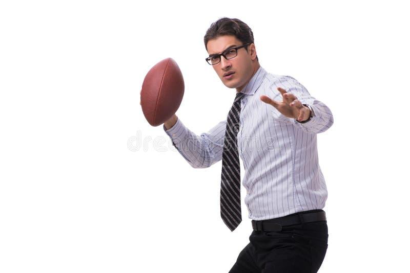 Den unga affärsmannen med amerikansk fotboll som isoleras på vit arkivfoto