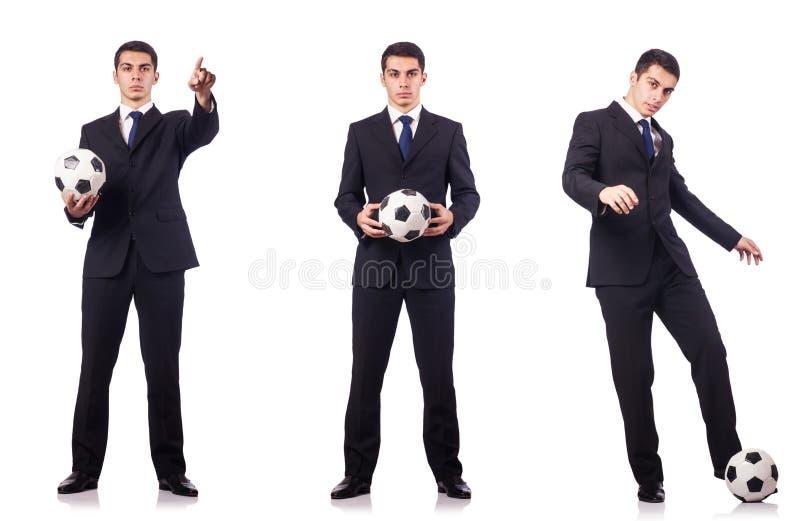 Den unga affärsmannen med fotboll på vit arkivbilder