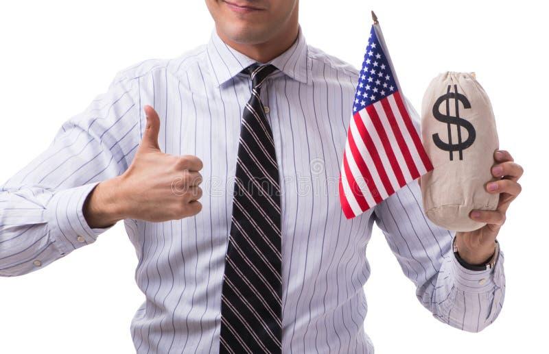 Den unga aff?rsmannen med amerikanska flaggan och pengar plundrar p? vit arkivfoton