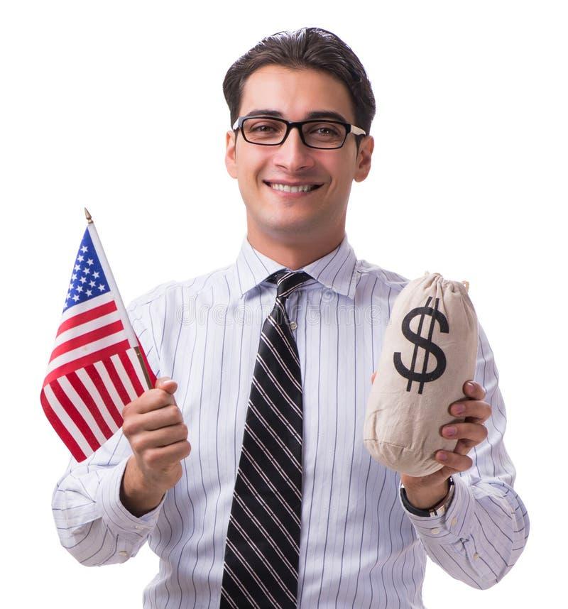 Den unga aff?rsmannen med amerikanska flaggan och pengar plundrar p? vit arkivfoto