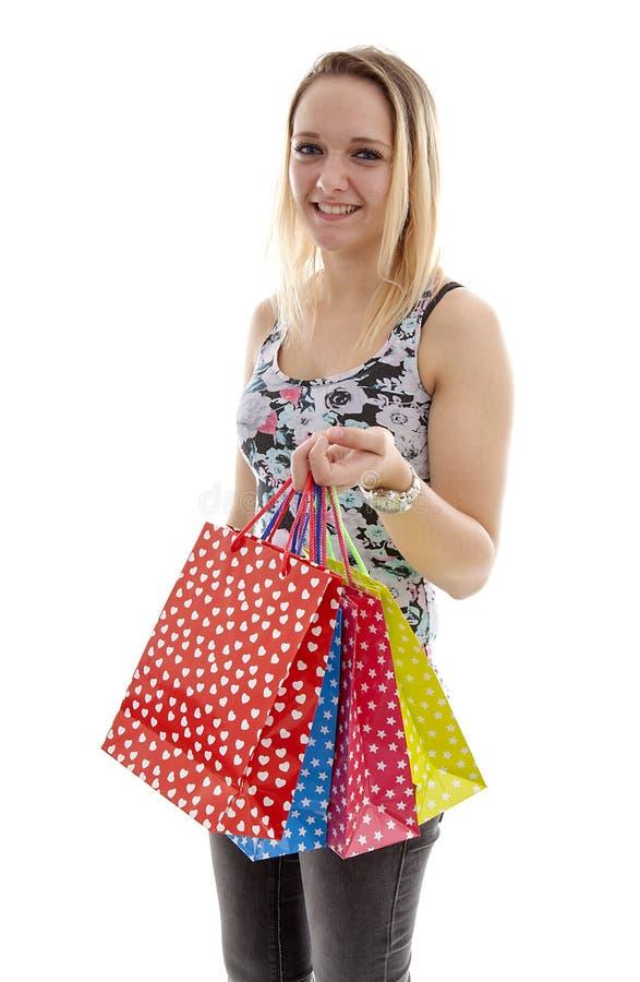 Den unga attraktiva flickan shoppar fotografering för bildbyråer