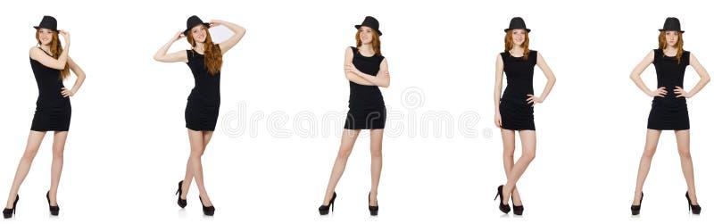 Den unga damen i svart klänning med den svarta hatten royaltyfria bilder