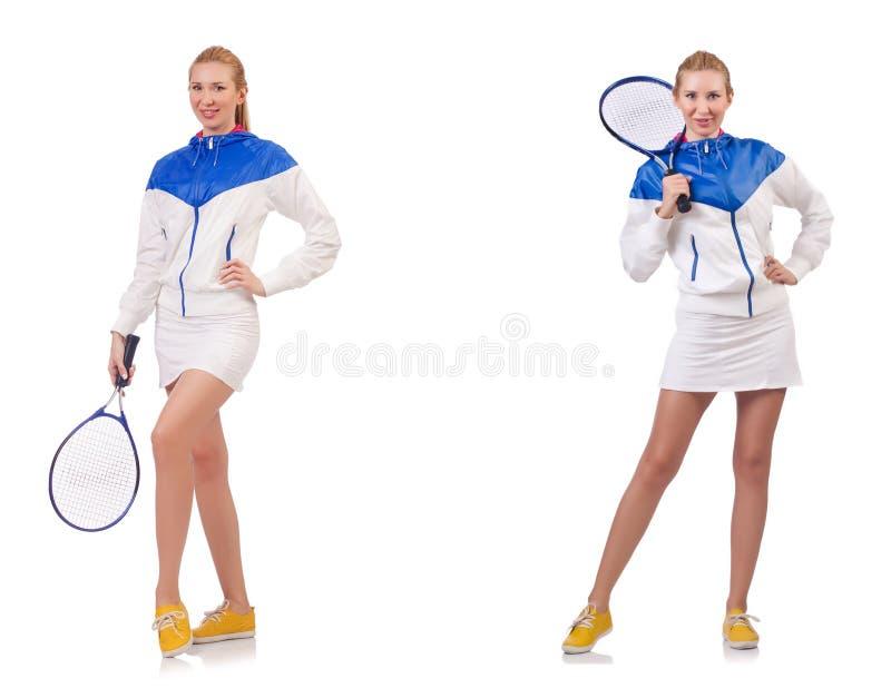 Den unga härliga damen som spelar tennis som isoleras på vit royaltyfria bilder