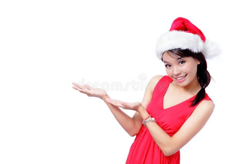 Den unga julflickan introducerar något fotografering för bildbyråer