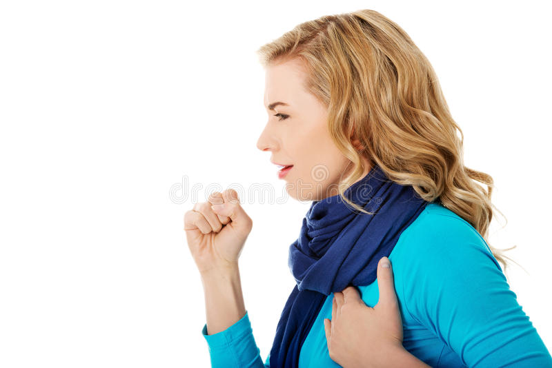 Den unga kvinnan har en influensa arkivbild