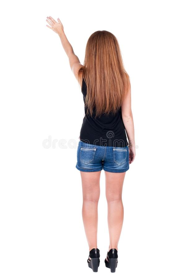 Den unga kvinnan i jeans trycker på ner arkivfoton