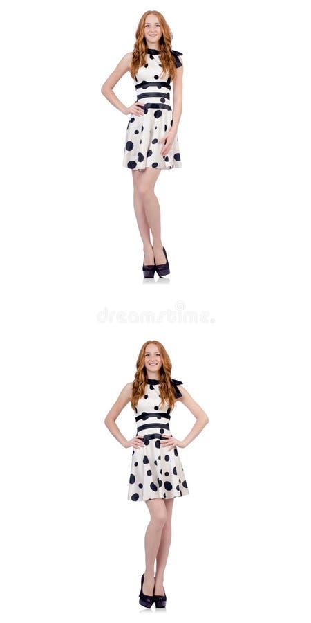 Den unga kvinnan i prickklänningen som isoleras på vit stock illustrationer