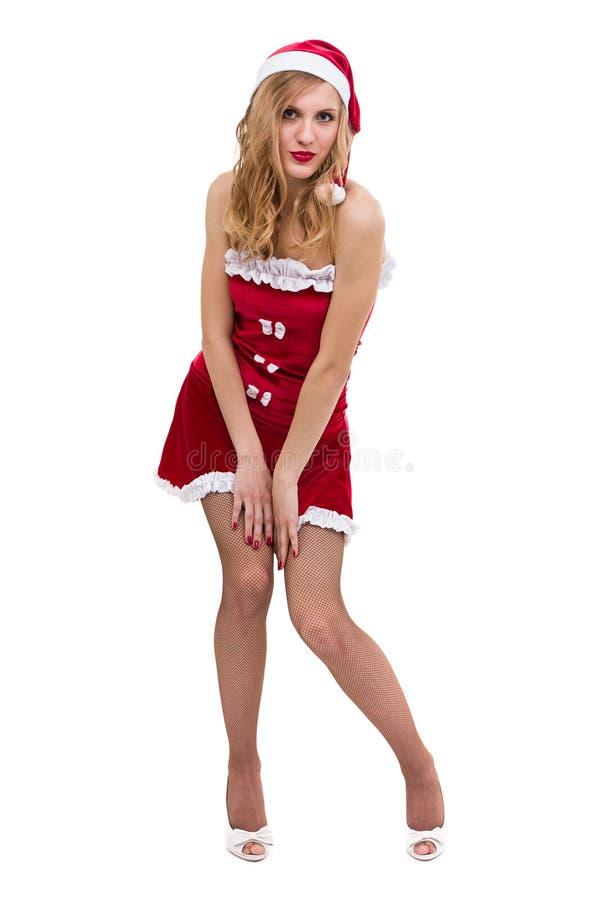 Den unga kvinnan som bär Santa Claus, beklär att posera mot isolerad vit royaltyfria bilder
