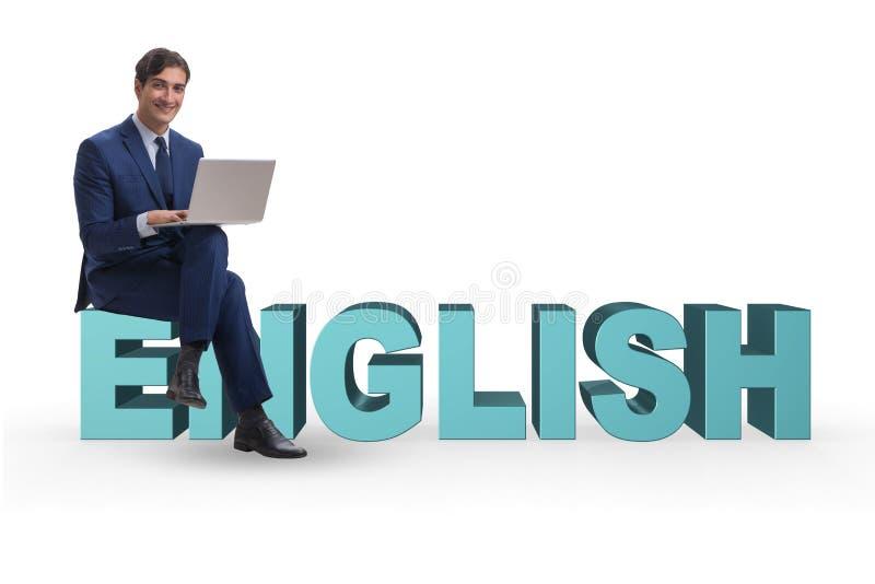 Den unga mannen i engelskt studerande lärande begrepp arkivfoto