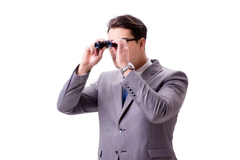 Den unga mannen med kikare som isoleras på vit royaltyfri fotografi